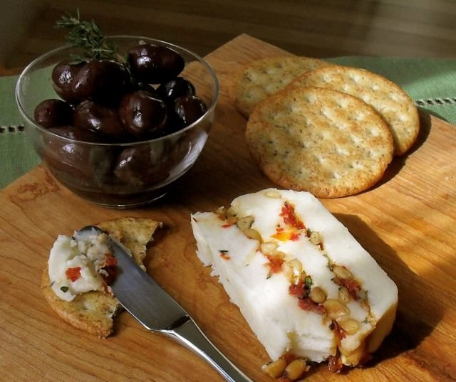 Cheddar Terrine with Sundried Tomatoes and Pine Nuts