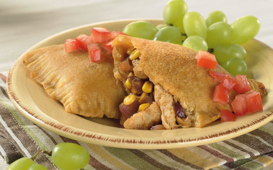 Double-Duty Chicken Pizza Pockets with Cabot Light Cheddar